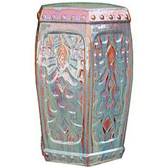 Fine ceramic garden stool features an authentic Chinese dynasty designHand-painted garden accent is available in a red/kiwi color optionUse stool as a functional seat or a patio decor accent piece