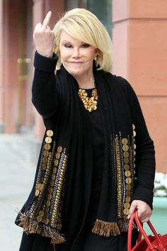 "Joan Rivers Out and About Do what she's doing! Smile, show that finger, and shout, ""FUCK WHAT YOU THINK!"""