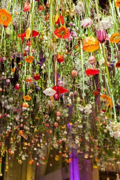 Rebecca Louise Law installation of flowers dripping from the ceiling.