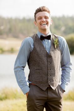Boho groom wedding attire idea - blue button-down. tweed vest and dark brown bow tie {Alison Rose Photography}