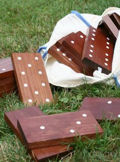 "Outdoor dominoes tutorial.  Cut 7"" pieces of 1x4 knot-less pine.  They stained but I would paint so woodgrain doesn't mark dominos.  They made adhesive dots, but use an exacto knife to cut out stencils would work even better.  Simply paint and play when dry."