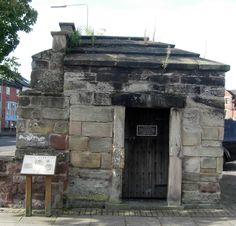 """The medieval lockup in Stafford, Staffordshire, England. This single-cell """"gaol"""" (as """"jail"""" was spelt until the 20th Century in Great Britain) was typical of Elizabethan England and would have held prisoners awaiting public torture or execution in front of crowds in Stafford's town centre. The old gaol was replaced in the 17th century and became a storage shed before being preserved as a historic site."""