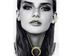 Styling by emma_dalgaard showing Govinda Tusk Necklace Shiny Gold, Govinda Tusk Ear Studs Shiny Gold, Delight Five Septum Ring Gold and Delight Double Diamond Ear Studs Small 14K Gold #jewellery #Jewelry #bangles #amulet #dogtag #medallion #choker #charms #Pendant #Earring #EarringBackPeace #EarJacket #EarSticks #Necklace #Earcuff #Bracelet #Minimal #minimalistic #ContemporaryJewellery #zirkonia #Gemstone #JewelleryStone #JewelleryDesign #CreativeJewellery #OxidizedJewellery #gold #silver…