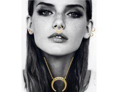 Styling by emma_dalgaard showing Govinda Tusk Necklace Shiny Gold, Govinda Tusk Ear Studs Shiny Gold, Delight Five Septum Ring Gold and Delight Double Diamond Ear Studs Small 14K Gold #jewellery #Jewelry #bangles #amulet #dogtag #medallion #choker #charms #Pendant #Earring #EarringBackPeace #EarJacket #EarSticks #Necklace #Earcuff #Bracelet #Minimal #minimalistic #ContemporaryJewellery #zirkonia #Gemstone #JewelleryStone #JewelleryDesign #CreativeJewellery #OxidizedJewellery #gold #silver…