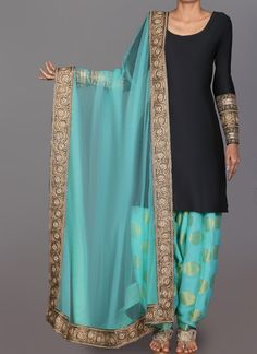 Description Black and Mint Brocade Punjabi Suit features a taffeta silk kameez alongside a brocade bottom with santoon inner and net dupatta. Embroidery is completed with zari, lace and stone…More Indian salwar Click Visit link for more info Designer Salwar Kameez, Designer Punjabi Suits, Indian Designer Outfits, Wedding Salwar Kameez, Designer Dresses, Salwar Designs, Patiala Suit Designs, Blouse Designs, Simple Indian Suits