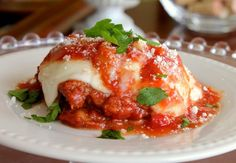 Eggplant Parmesan Recipe – Just like Mom and Grandma used to make! The crunchy eggplant combined with homemade marinara sauce and melted mozzarella cheese is just a magical combination.