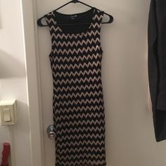 Black & gold chevron dress Black and gold fitted dress from Forever 21! Only worn twice and I've been looking for another reason to wear it again. It's knee length and fitted, perfect for a dressy occasion Forever 21 Dresses Midi