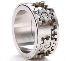 Who says jewelry can't be interactive? The moving gears ring is a masterpiece of wearable engineering - with a simple twist of your fingers, you can make the gears on this handsome ring come to life - making it the ultimate wedding band for engineer geeks.