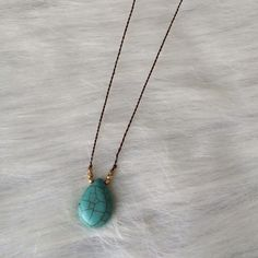 """Turquoise pendant necklace Turquoise colored pendant necklace  Adjustable clasp closure. Lightweight. Chain length 16"""" (plus additional 3.5"""" extender) NWT. Brand new with tags. Comes with earrings (see photos).  Availability- 2 Price is firm unless bundled. No tradesAll jewelry gets a great discount when bundled!! Boutique Jewelry Necklaces"""