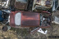 Red, rusty, forgotten car.  The remote Swedish scrapyard where old cars rust in peace! Photographed with a drone. https://airbuzz.one/drone-pictures-of-bastnas-car-cemetery/ #dronephoto #droneblogg #djiblogg #djimavicpro #dji #carcemetery #sweden #carwrecks #oldcars #rustycars #cars #sweden #bilskroten #båstnäs #dronephotography