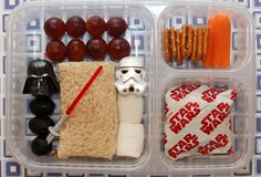 • Red-seedless grapes  • Darth Vader cupcake ring with black olives for his body and a lightsaber  • A sandwich  • Stormtrooper cupcake ring with marshmallows for his body  • Pretzels  • Carrot sticks  • Star Wars Fruit Snack Pack