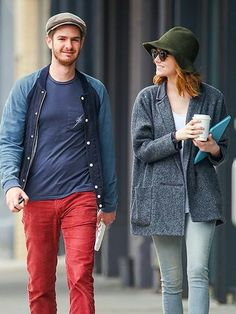 Andrew Garfield leads the way during a stroll with his The Amazing Spider-Man 2 co-star and real-life love Emma Stone on Wednesday in New York City.