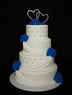 Wedding Cakes On a simpler smooth cake this swooshy icing seems to tie the layers together without &; Wedding Cakes On a simpler smooth cake this swooshy icing seems to tie the layers together without &; Royal Blue Wedding Cakes, Cool Wedding Cakes, Elegant Wedding Cakes, Beautiful Wedding Cakes, Gorgeous Cakes, Wedding Cake Designs, Pretty Cakes, Amazing Cakes, Wedding Ideas