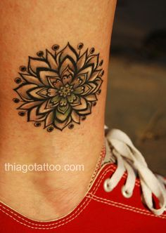 Mandala tattoo, I love the subtle color in this one!
