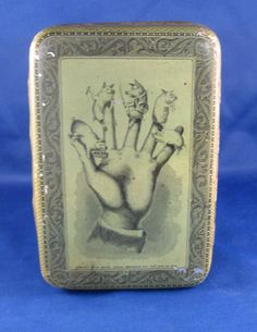 5 Little Pigs Fingers Candy Tin.....  Somers Bros..... 1879