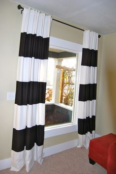 Another blogger's idea for black and white striped curtains. Sew black panels onto white curtains.