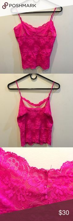 Betsey Johnson Hot Pink Lace Camisole Top Betsey Johnson Hot Pink Cami top with Lace all over and has thin straps and a tiny hole in photo above in the center of the chest! Size medium and worn once! Betsey Johnson Tops