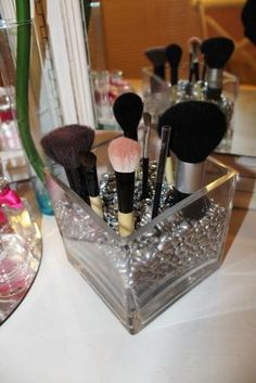 DIY- Use painted beans in a vase to hold makeup brushes!! the ones I use have my initials on them, and I bought them from glitzy glam.  But you could totally do your own, using any container and beads or fill from hobby lobby