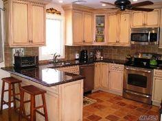 perfect kitchen if it had dark wood floors