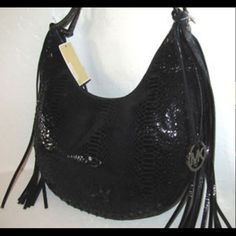 RARE, MK MUST HAVE! MK signature FLAIR. PYTHON WITH BLACK CRYSTALS  & long leather fringe detailing. Fringe with python embossed This bag has all the makings of a fashion hit!  Adjustable strap for comfortable carrying 24' to 26' max. Strap drop. Inside pockets lined & zip closure. Michael Kors Bags