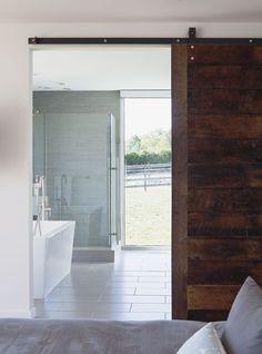 Sliding bathroom barn door - wish I had a home large enough to incorporate a barn door.