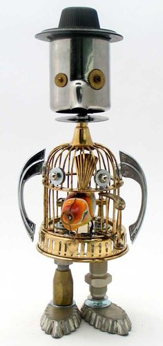 """""""Jack Sparrow""""   Height: 14.5""""   Principal Components: Bird cage, cream pitcher, wind up bird, cabinet pulls, dial, hose fittings, tartlet tins"""