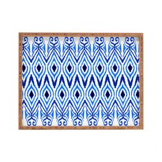 Dinner trays of yesteryear were never this cool. Not only can this patterned beauty hold your organic dinner, but it'll also serve as a clever styling tool. Pile up magazines, books, and a knickknack o...  Find the Blue Symmetry Tray, as seen in the Moods of #Indigo Collection at http://dotandbo.com/collections/moods-of-indigo?utm_source=pinterest&utm_medium=organic&db_sku=DNY0164