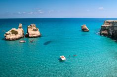 Top 10 Puglia Beaches in Italy The 'Two Sisters' faraglioni rocks of Torre Dell'Orso. By: Giacomo Carena