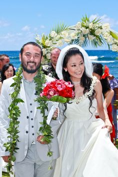 A beautiful oceanfront wedding ceremony at The Beach House on Kauai.