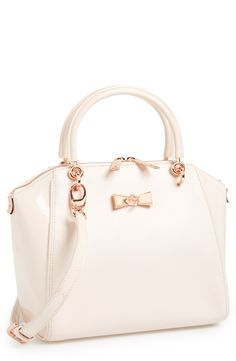 Nude pink tote with a dainty rose gold bow.