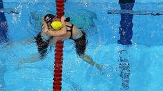Emily Seebohm congratulates Missy Franklin after the women's 100m Backstroke final