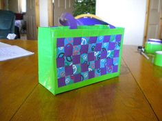 """From """"instructables.com"""" -- a fun site with tutorials on """"how-to"""" make crafts of all sorts. Yes, including this clever """"Duck-Tape-Tote""""!  (really, have you seen all the Wow Colors that Duck-Tape comes in?)"""