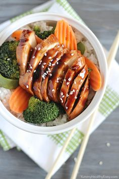 Delicious Chicken Teriyaki Bowls with chicken baked in a homemade teriyaki sauce layered on top of a bed of rice & veggies!