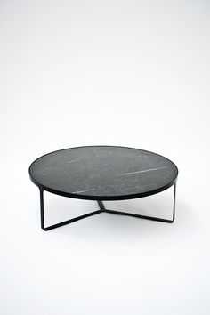 // Black coffee table with top in Maruina Black marble. 'Cage' by Gordon Guillaumier for Tacchini.