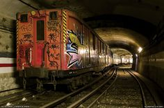 """My novel """"Subway Hitchhikers"""" runs through a world like this. Mouth of the abandoned tunnel filled with vintage Sprague Thompson rolling stock. Abandoned Buildings, Abandoned Places, Sleep City, Trains, Paris Metro, Graffiti Artwork, Rolling Stock, Bus, Urban Exploration"""