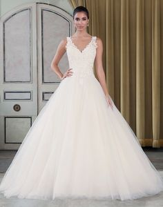 Justin Alexander signature wedding dresses style 9793 Beaded Venice lace and tulle ball gown with a v-neck neckline.