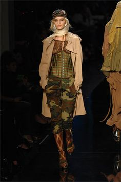 Jean Paul Gaultier made an entire like solely made from camouflage! The war was a very influential time for fashion.Jean Paul Gaultier Spring 2008 RTW - Runway Photos - Fashion Week - Runway, Fashion Shows and Collections - Vogue Camouflage Fashion, Camo Fashion, Couture Fashion, Fashion Show, Paris Fashion, Runway Fashion, Jean Paul Gaultier, Paul Gaultier Spring, Military Inspired Fashion