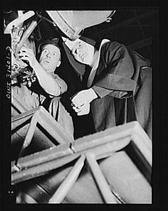 """Washington, D.C. Sister Aquinas, 'flying nun,' exchanging trade secrets with an engineer at the Washington National Airport,"" June 1943."