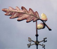 Single Oak Leaf Weather Vane by West Coast Weather Vanes. This Oak Leaf weathervane sculpture piece comes either in all copper or a combination of a copper leaf with a copper and brass nut.