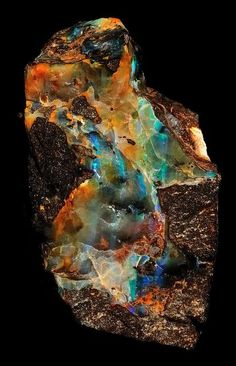 Opal with stunning flashes of fire in matrix