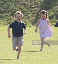 Prince George of Cambridge and Princess Charlotte of Cambridge run together during the Maserati Royal Charity Polo Trophy at Beaufort Park on June 10, 2018 in Gloucester, England. (Photo by Samir Hussein/Samir Hussein/WireImage)