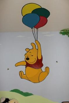 Winnie the Pooh baby room. Mural up to the ceiling. Too bad I won't be able to paint a mural in my apartment.