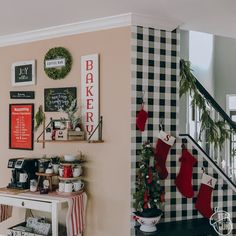 Christmas Gallery Wall & Kitchen Decor- 2018 - The Teal Acorn Little Christmas Trees, Last Christmas, Kitchen Gallery Wall, Mini Cake Stand, Cow Creamer, Red Plates, Knit Stockings, Bannister, White Dishes