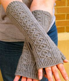 Knitting Pattern for Totally Cabled Fingerless Gloves - These fingerless mitts feature two distinct cables, as well as one twisted stitch. Instructions are written out and charted.