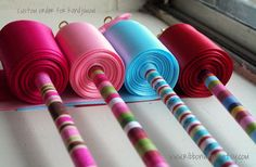 Striped Ribbon Wands A minimum of 6 feet of swiss made satin ribbon is then attached and each end of the ribbon is sealed, so there is no worry of the ribbon fraying with use. Many people have requested grosgrain or patterned ribbon unfortunately this ribbon does not provide the best play experience and I just can't sell something I don't find fun to play with even if it looks pretty. We have experimented with every type of ribbon & have found that satin is the most satisfying choice for ribbon.