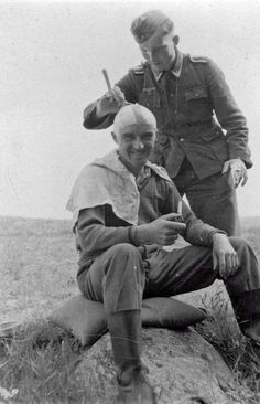 "waffenss1972: ""A German soldier shaves his comrade on the front line """