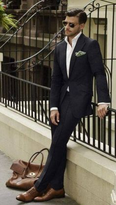 I like this black suit with brown shoes idea...