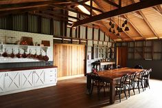 This modern barn conversion features rustic-luxe details, conceived by architecture firm Built by Wilson, located in the countryside of Victoria, Australia.