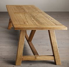 RH's Reclaimed Russian Oak Trestle Rectangular Dining Table:Handcrafted of solid oak timbers reclaimed from decades-old buildings in Russia, our stout and sturdy trestle table bears all the hallmarks of aged wood – nicks, knots, nail marks and other imperfections – that celebrate its provenance and enduring beauty.