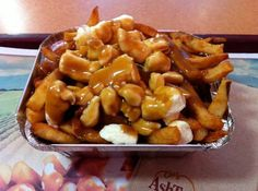 Poutine is a Quebec speciality! It's made with french fries, topped with brown gravy and curd cheese. An acquired taste. Belinda gives it the thumbs up! Quebec Winter Carnival, Acquired Taste, Poutine, Fried Potatoes, French Fries, Potato Recipes, Macaroni And Cheese, Canada Eh, Eat
